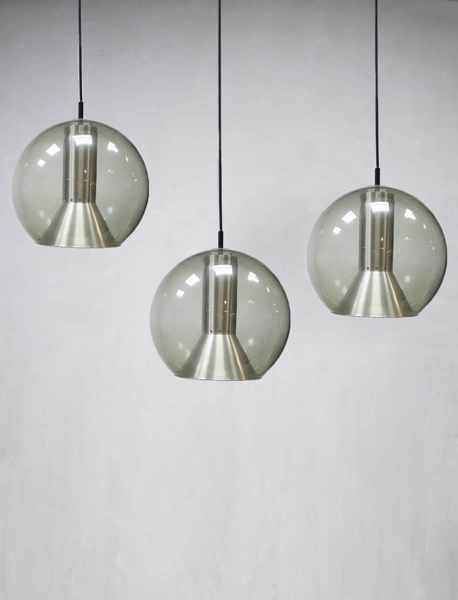 Large globe pendant lamp by Frank Ligtelijn for Raak vintage glazen globe lampen