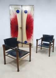 midcentury safari chairs Kaare Klint leather safari stoelen